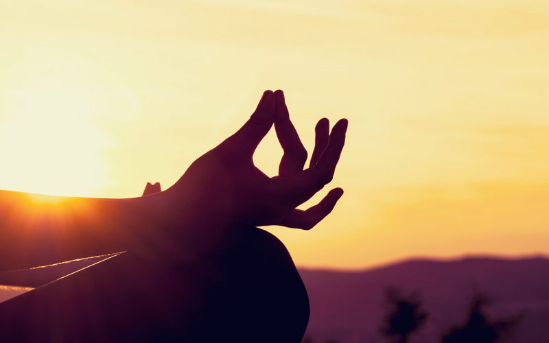 yoga mudra sunset